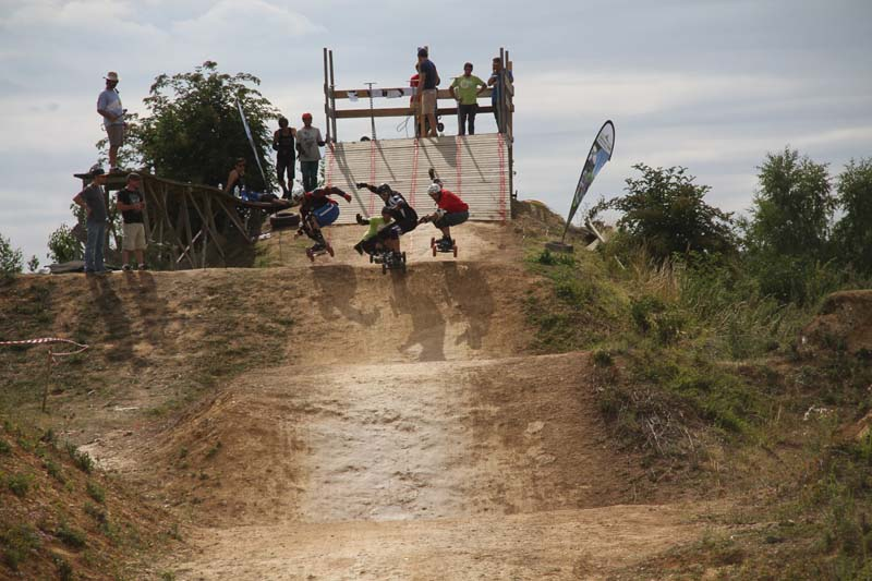 Masters riding the boardercross course
